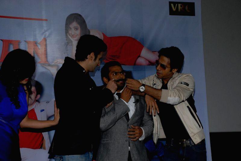 Actors Gunjan Malhotra and Sharib Hashmi during the press conference of film Badmashiyan in Mumbai on 28th January 2015. - Gunjan Malhotra and Sharib Hashmi