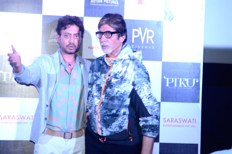 Actors Irrfan Khan and Amitabh Bachchan during the trailer launch of film Piku in Mumbai on March 25, 2015. - Irrfan Khan and Amitabh Bachchan