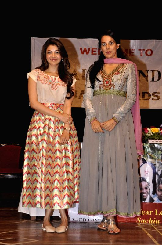 Actors Kajal Agarwal and Pooja Bedi during fund collection drives for NGO - Alert India (Controlling Leprosy and spreading Cancer Awareness) in Mumbai on Feb 21, 2015.
