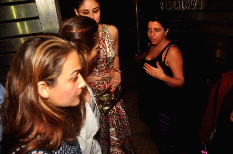 Actors Kareena Kapoor, Amrita Arora, Malaika Arora Khan and filmmaker Zoya Akhtar during her party in Mumbai on Feb. 16, 2015. - Kareena Kapoor, Amrita Arora and Malaika Arora Khan