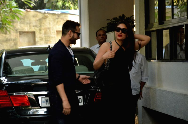 Actors Kareena Kapoor and Saif Ali Khan at the annual Christmas lunch hosted by Sashi Kapoor in Mumbai, on December 25, 2014. - Kareena Kapoor, Saif Ali Khan and Sashi Kapoor