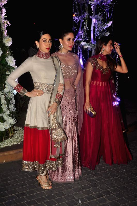 Actors Karisma Kapoor and Kareena Kapoor during Riddhi Malhotra and Tejas Talwalkar's sangeet ceremony in Mumbai, on December 13, 2014. - Karisma Kapoor and Kareena Kapoor