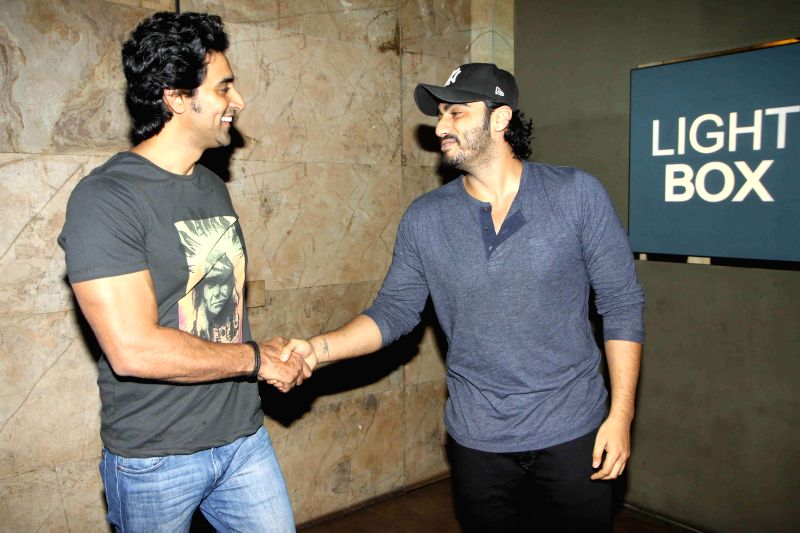 Actors Kunal Kapoor and Arjun Kapoor during the screening of film In Their Shoes in Mumbai, on March 10, 2015. - Kunal Kapoor and Arjun Kapoor