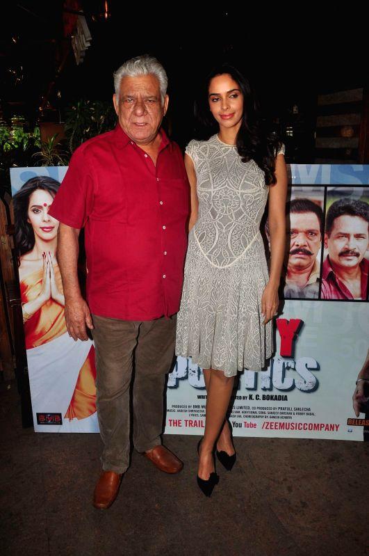 Actors Mallika Sherawat and Om Puri during the press conference of film Dirty Politics, in Mumbai, on Dec 21, 2014. - Mallika Sherawat