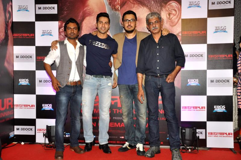 Actors Nawazuddin Siddiqui, Varun Dhawan, filmmakers Dinesh Vijan and Sriram Raghavan during the success party of the film Badlapur in Mumbai on Feb 27, 2015. - Nawazuddin Siddiqui and Varun Dhawan