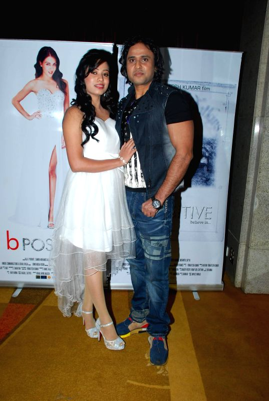 Actors Raj K Purohit and Nibedita Biswal during poster launch of film B positive in Mumbai, on Jan. 19, 2015. - Raj K Purohit and Nibedita Biswal