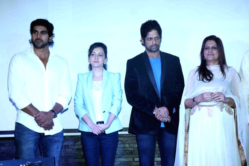 Actors Rajeev Pillai, Sulagna Panigrahi and Rajesh Shringarpure and filmmaker Kiran Phadnis during the first look and music launch of Ek Adbhut Dakshina Guru Dakshina in Mumbai on March 25, ... - Rajeev Pillai, Sulagna Panigrahi and Rajesh Shringarpure