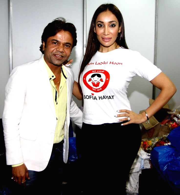 Actors Rajpal Yadav and Sofia Hayat during the Rajasthan Day celebration in Mumbai on March 30, 2015. - Rajpal Yadav and Sofia Hayat