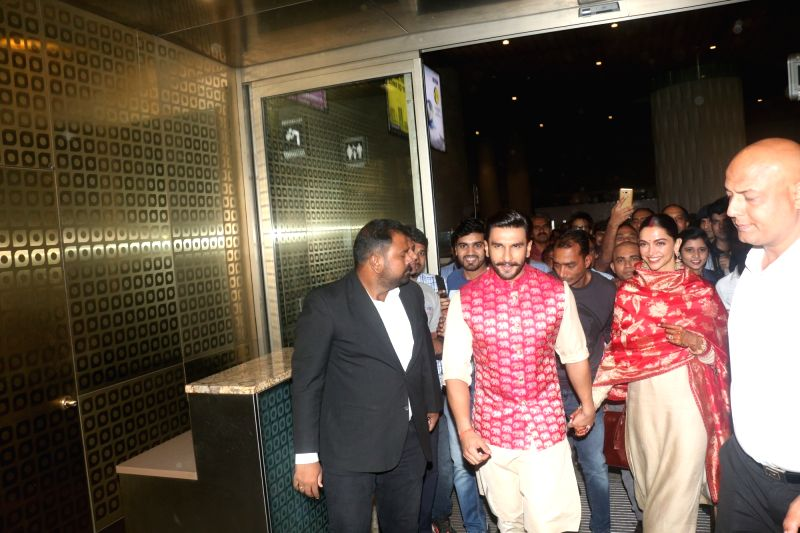 :Mumbai: Actors Ranveer Singh and Deepika Padukone wave at fans as they return to Mumbai from Italy after their wedding, on Nov 18, 2018. (Photo: IANS).(Image Source: IANS)