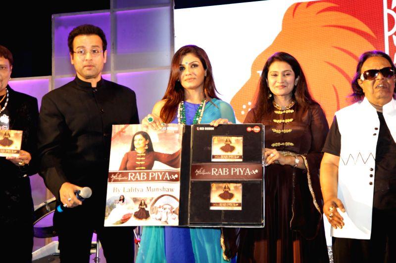 Actors Raveena Tandon, Rohit Roy, singer Lalitya Munshaw and music composer Ravindra Jain during the launch of Lalitya Munshaw's music album 'Rab Piya in Mumbai, on November 16, 2014. - Rohit Roy and Ravindra Jain