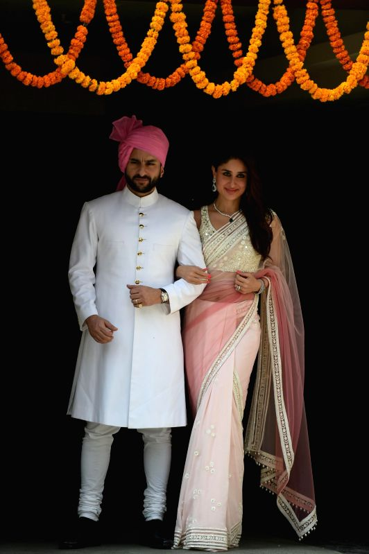 Actors Saif Ali Khan and Kareena Kapoor during the wedding ceremony of Soha Ali Khan and Kunal Khemu in Mumbai, on Jan. 25, 2015. - Saif Ali Khan, Kareena Kapoor and Soha Ali Khan