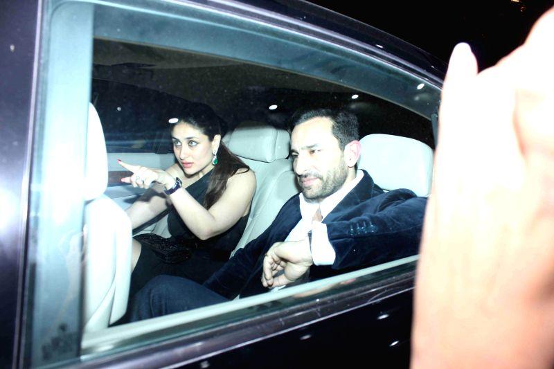 Actors Saif Ali Khan and Kareena Kapoor during the birthday party of actor Randhir Kapoor in Mumbai on Feb 15, 2015. - Saif Ali Khan and Kareena Kapoor