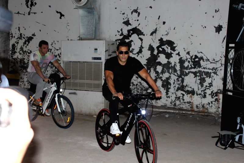 Mumbai: Actors Salman Khan and Arbaaz Khan during the launch of Being Human electric bicycles in Mumbai on June 5, 2017. - Salman Khan and Arbaaz Khan