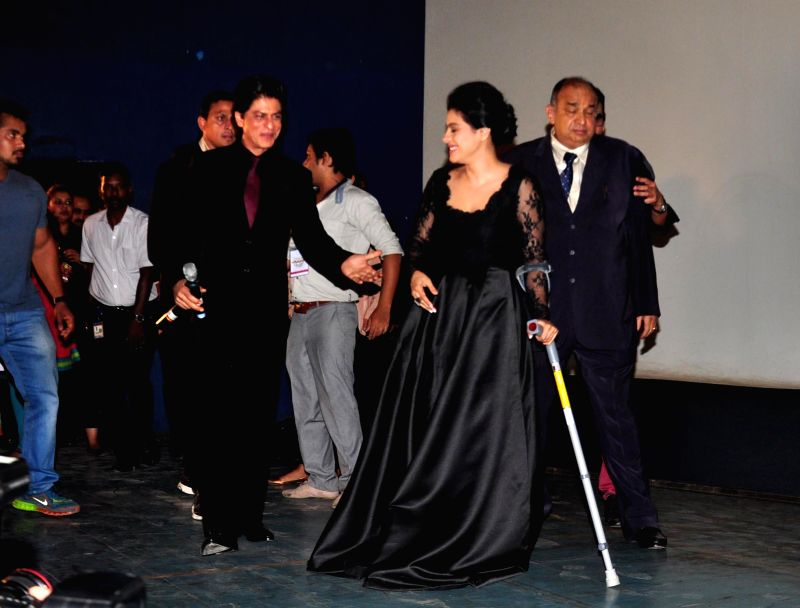 Actors Shahrukh Khan and Kajol Devgan at Maratha Mandir theatre to celebrate 1000 weeks of film Dilwale Dulhaniya Le Jayenge, in Mumbai on Dec. 12, 2014. - Shahrukh Khan and Kajol Devgan