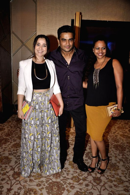 Actors Simone Singh and R. Madhavan along with his wife during the launch of Fahad Samar`s book `Flash Point` at Palladium in Mumbai, on Feb. 8, 2015. - Simone Singh and R. Madhavan