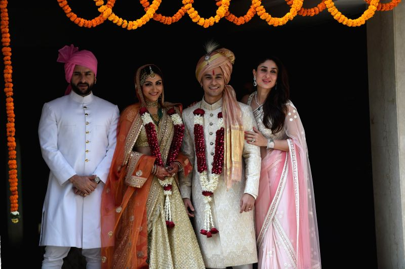 Actors Soha Ali Khan and Kunal Khemu along with Saif Ali Khan and Kareena Kapoor pose for photo after their wedding at a private ceremony in Mumbai, on Jan. 25, 2015. - Soha Ali Khan, Kunal Khemu, Saif Ali Khan and Kareena Kapoor