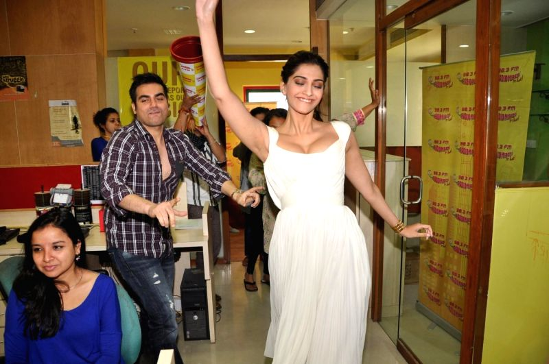 Actors Sonam Kapoor, filmmaker Arbaaz Khan at Radio Mirchi studio for promotion of their upcoming film Dolly Ki Doli in Mumbai, on Jan. 09, 2015. - Sonam Kapoor and Arbaaz Khan