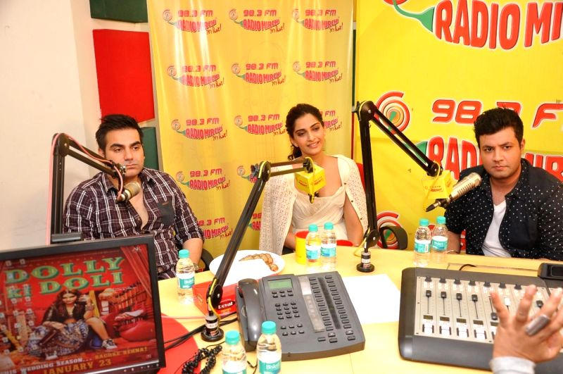 Actors Sonam Kapoor, Varun Sharma and filmmaker Arbaaz Khan at Radio Mirchi studio for promotion of his upcoming film Dolly Ki Doli in Mumbai, on Jan. 09, 2015. - Sonam Kapoor, Varun Sharma and Arbaaz Khan