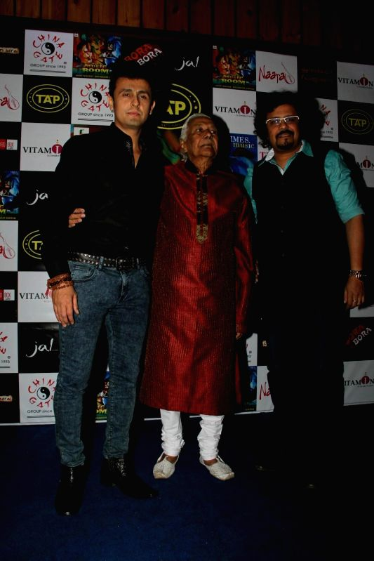 Actors Sonu Nigam and Bickram Ghosh celebrates their selection in Oscar for movie Jal in Mumbai on Feb 25, 2015.