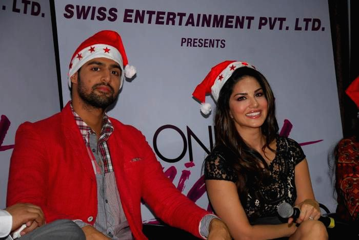 Actors Tanuj Virwani and Sunny Leone promotions of their up-coming film `One Night Stand`in Mumbai, on Dec. 24, 2014. - Tanuj Virwani and Sunny Leone