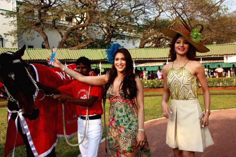 Actors Urvashi Rautela and Urvashi Rautela during the 26th Poonawalla Breeders Multi-Million (PBMM), race in Mumbai, on Feb 22, 2015. - Urvashi Rautela