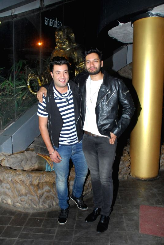 Actors Varun and Ali Fazal Sharma during the birthday celebrations of actor Richa Chadda in Mumbai, on Dec. 17, 2014. - Varun and Ali Fazal Sharma