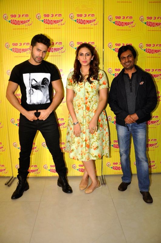 Actors Varun Dhawan and Huma Qureshi during promotion of their upcoming movie Badlapur in Mumbai on Jan 17, 2015. - Varun Dhawan and Huma Qureshi