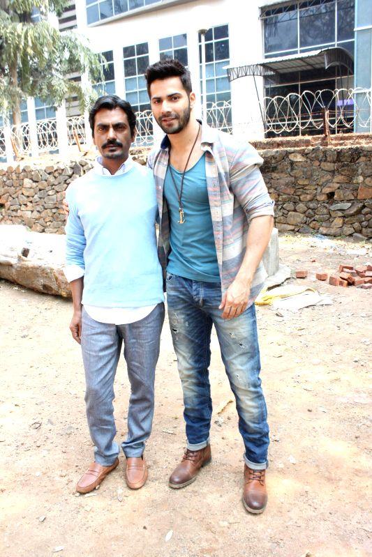 Actors Varun Dhawan and Nawazuddin Siddiqui on the sets of Savdhaan India in mumbai on Feb. 8, 2015. (Phato: IANS)
