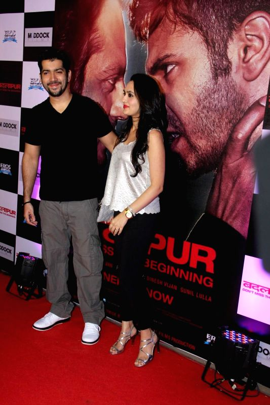 Actors Varun Dhawan and Preity Zinta during the success party of the film Badlapur in Mumbai on Feb 27, 2015. - Varun Dhawan and Preity Zinta