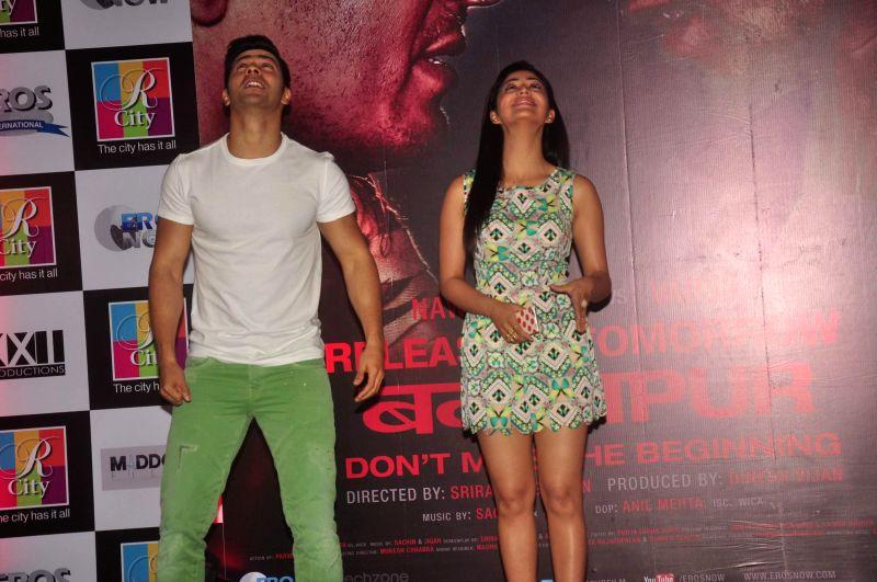 Actors Varun Dhawan and Yami Gautam during the promotion of the film Badlapur, in Mumbai on Feb 19, 2015. - Varun Dhawan and Yami Gautam