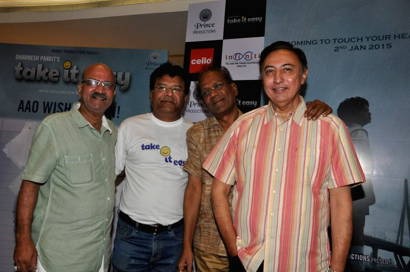Actors Vijay Kashyap, Veerendra Saxena and Anang Desai during the launch of film Take It Easy at Infinity Mall, in Mumbai, on Dec 21, 2014. - Vijay Kashyap, Veerendra Saxena and Anang Desai