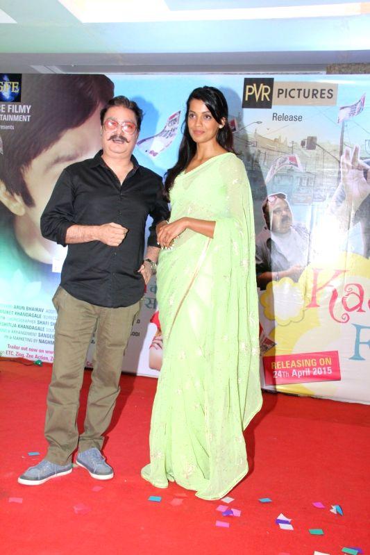 Actors Vinay Pathak and Mugdha Godse during the Music launch of film Kaagaz Ke Fools in Mumbai on April 19, 2015. - Vinay Pathak and Mugdha Godse