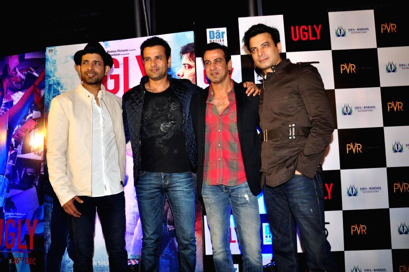 Actors Vineeth, Rohit Roy, Ronit Roy and Ali Fazal Kumar during the premiere of film Ugly in Mumbai on 23, Dec. 2014. - Vineeth, Rohit Roy, Ronit Roy and Ali Fazal Kumar