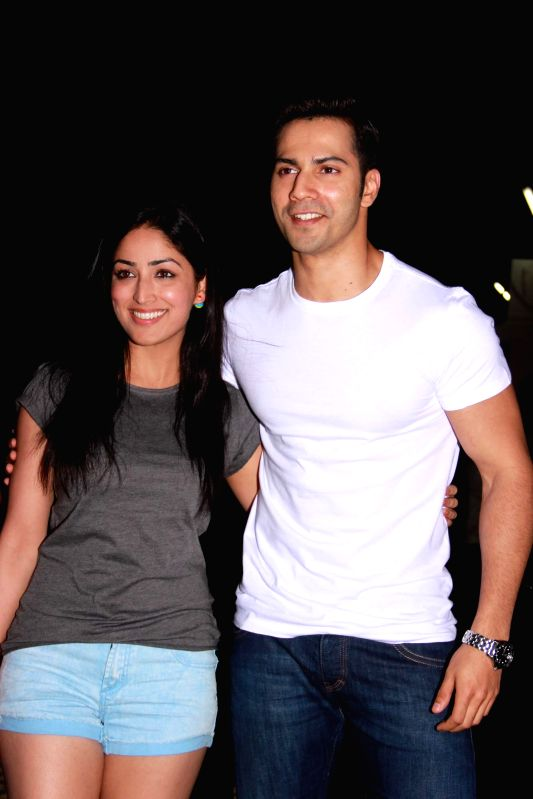 Actors Yami Gautam and Varun Dhawan during the special screening film Badlapur in Mumbai on Feb 19, 2015. - Yami Gautam and Varun Dhawan