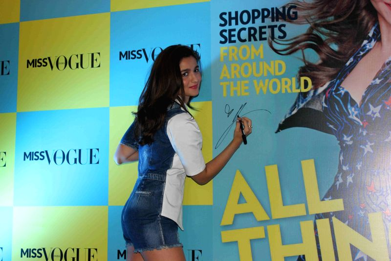 Actress Alia Bhatt during the launch of the first edition of Miss Vogue India with the cover in Mumbai on 13th April 2015.