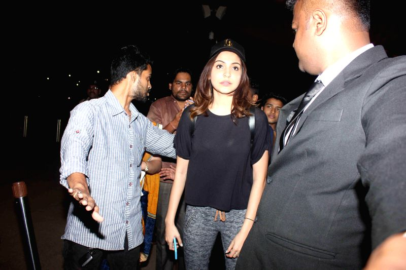 Actress Anushka sharma at Mumbai airport going for an ad film shoots in Bangkok, in Mumbai on March 19, 2015.