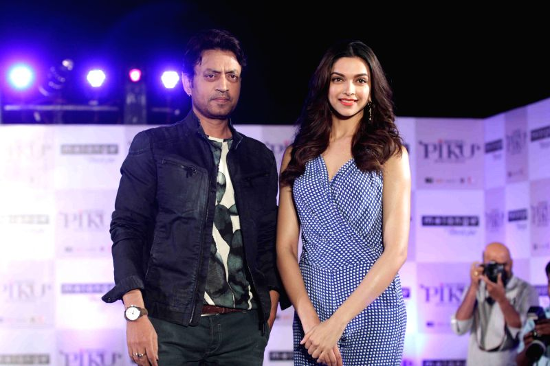 Actress Deepika Padukone and actor Irrfan Khan during the showcase of Melange by Lifestyle`s Piku inspired ethnic wear collection in Mumbai, on April 28, 2015.