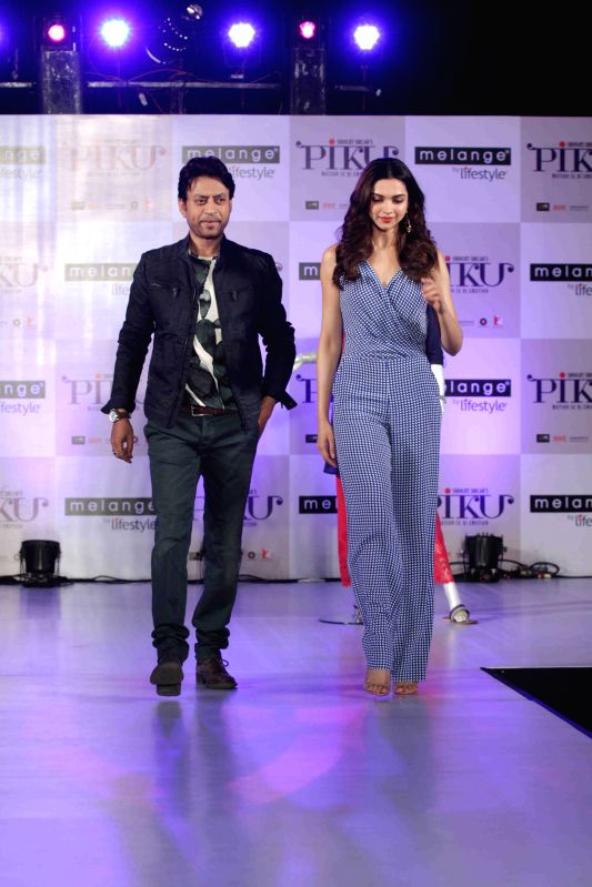 Actress Deepika Padukone and actor Irrfan Khan during the showcase of Melange by Lifestyle`s Piku inspired ethnic wear collection in Mumbai, on April 28, 2015.