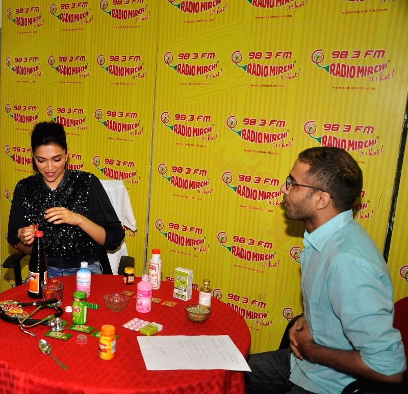 Actress Deepika Padukone treating the staff of Radio Mirchi during the promotion of Piku at Red FM studio, in Mumbai, on May 8, 2015. - Deepika Padukone