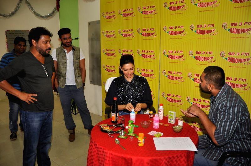 Actress Deepika Padukone treating the staff of Radio Mirchi during the promotion of Piku at Red FM studio, in Mumbai, on May 8, 2015. - Deepika Padukone
