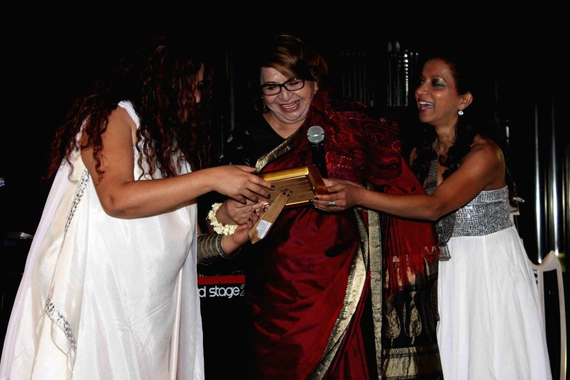 Actress Helen with jazz vocalist Vivienne Pocha (L) and music composer and pianist Merlin D`Souza (R), during a music concert by the all-women band INDIVA, in Mumbai on April 10, 2015.