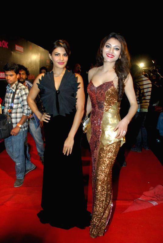 Actress Jacqueline Fernandez and Urvashi Rautela during the 21st Annual Life OK Screen Awards in Mumbai on Jan. 14, 2015. - Jacqueline Fernandez