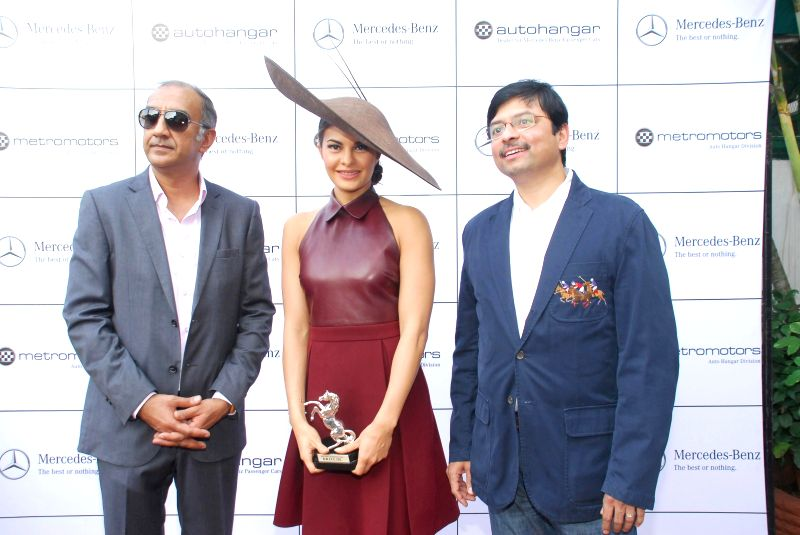 Actress Jaqueline Fernandez with filmmaker Milan Luthria during the Metro Motors Auto Hanger Sir H M Mehta Million trophy organised by bollywood filmmaker Milan Luthria at Mahalaxmi race ... - Jaqueline Fernandez