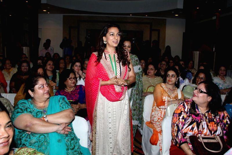Actress Juhi Chawla celebrated Women`s Day with Shaila Welfare Trust in Mumbai on March 12, 2015.