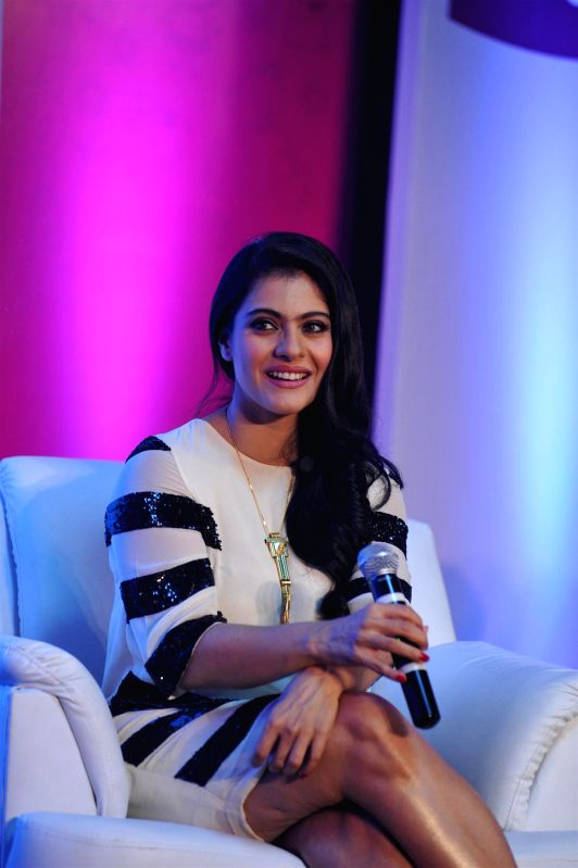 Actress Kajol during the felicitation of 7 winners of Huggies Priceless moments mobile campaign in Mumbai on Feb. 16, 2015. - Kajol