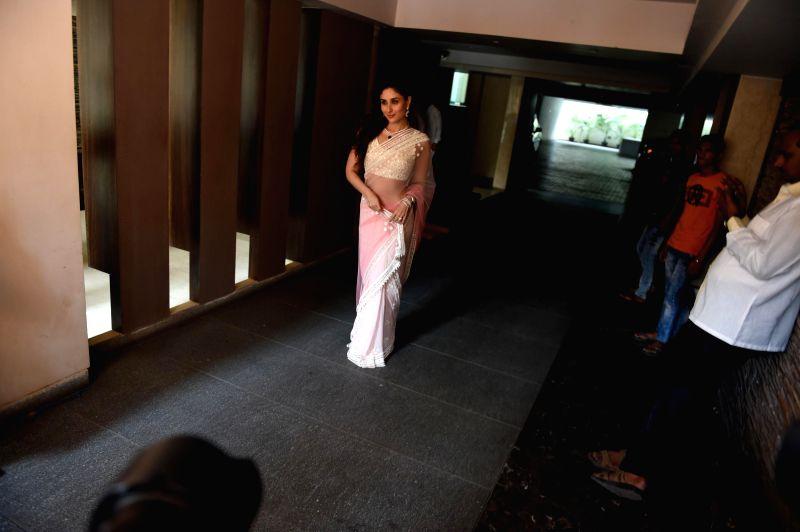 Actress Kareena Kapoor during the wedding ceremony of Soha Ali Khan and Kunal Khemu in Mumbai, on Jan. 25, 2015. - Kareena Kapoor and Soha Ali Khan