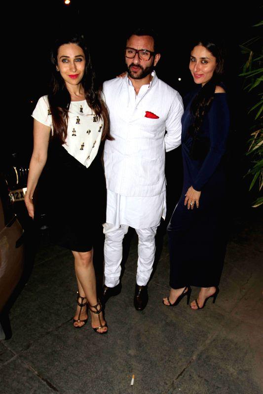 Actress Karishma Kapoor, actor Saif Ali Khan along with his wife and actress Karina Kapoor Khan during Babita Kapoor`s birthday party in Mumbai, on April 19, 2015. - Karishma Kapoor, Saif Ali Khan and Karina Kapoor Khan
