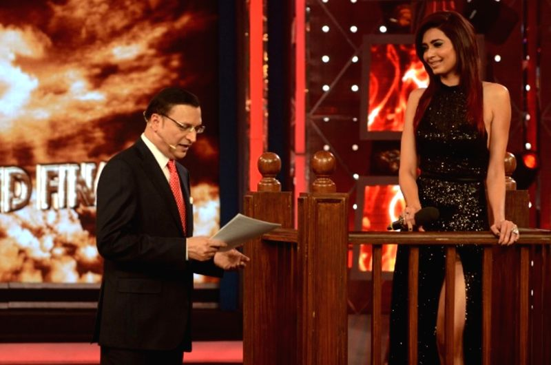 Actress Karishma Tanna with Rajat Sharma, Editor-in Chief of India TV on the sets of Bigg Boss Season 8 on Jan. 31, 2015. - Karishma Tanna and Rajat Sharma