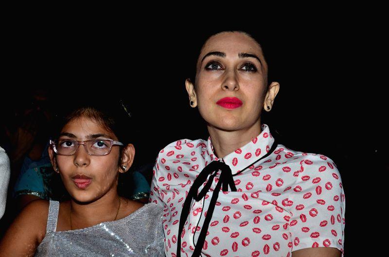 Actress Karisma Kapoor along with her daughter Samaira Kapoor during the Mumbai finale of Shiamak Davar`s show Winter Funk in Mumbai on Nov 28, 2014. - Karisma Kapoor and Samaira Kapoor