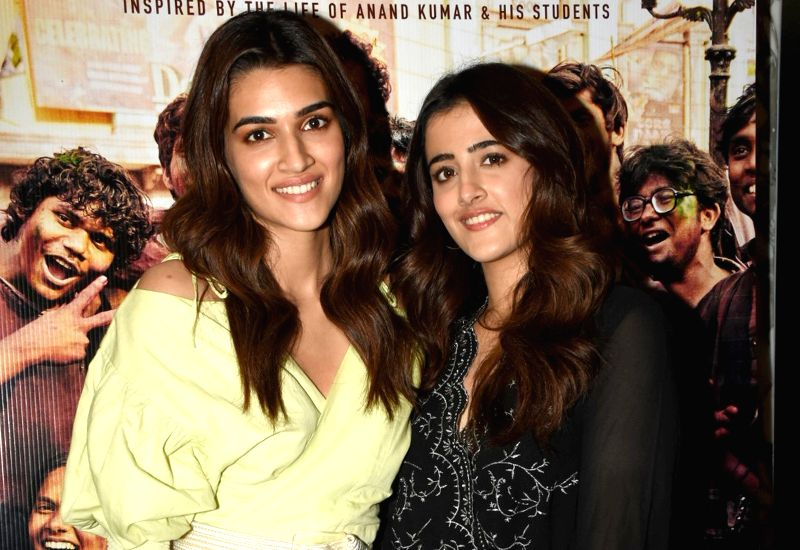 "Mumbai: Actress Kriti Sanon with her sister Nupur Sanon at the screening of upcoming film ""Super 30"" in Mumbai, on July 10, 2019."